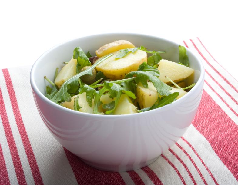 bowl filled with arugula and potato salad