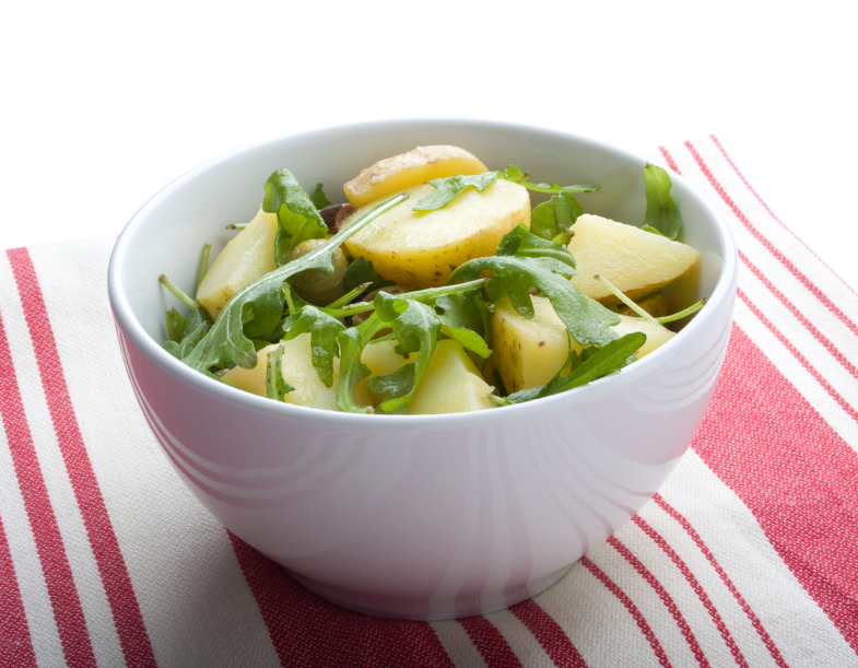 bowl filled with arugula and potato salad