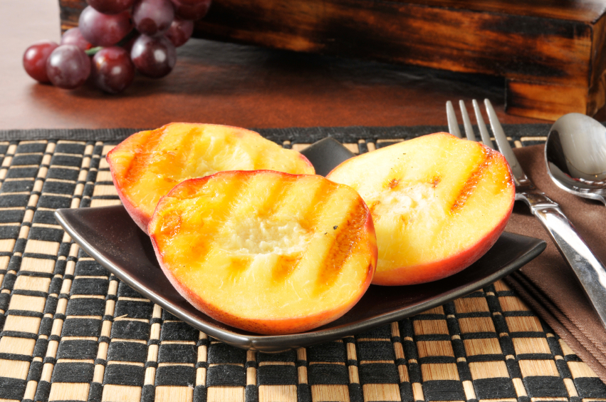 Grilled peaches with fork