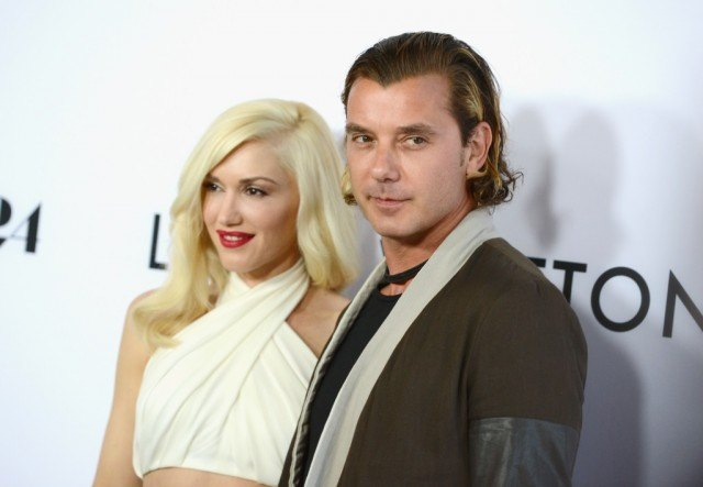 Gwen Stefani and Gavin Rossdale posing together at a red carpet event.