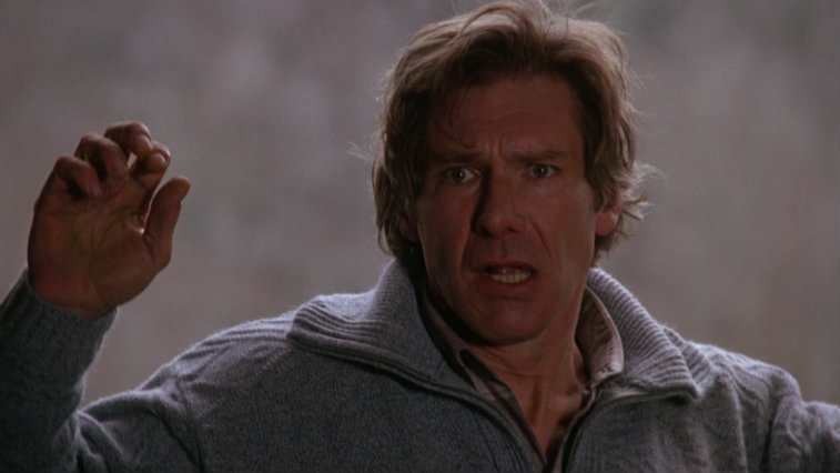 Harrison Ford holds up his hands in The Fugitive