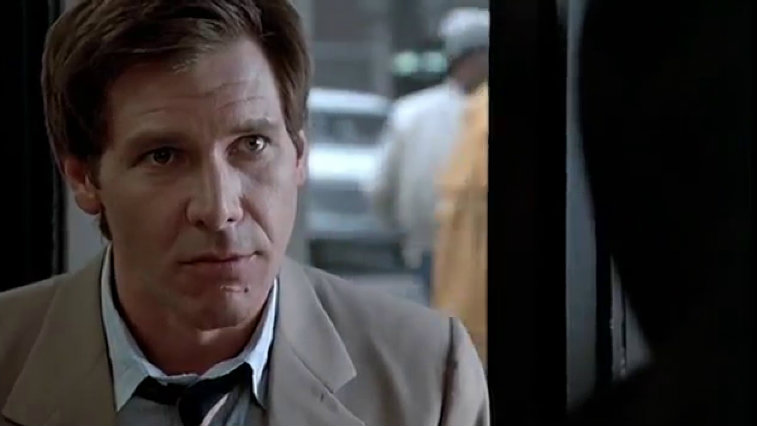 Harrison Ford wears a suit and stares ahead in Witness