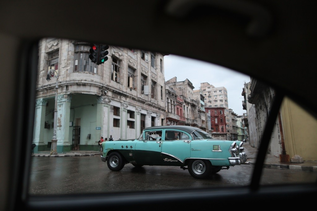 A classic American teal car is seen in Cuba's capital city of Havana