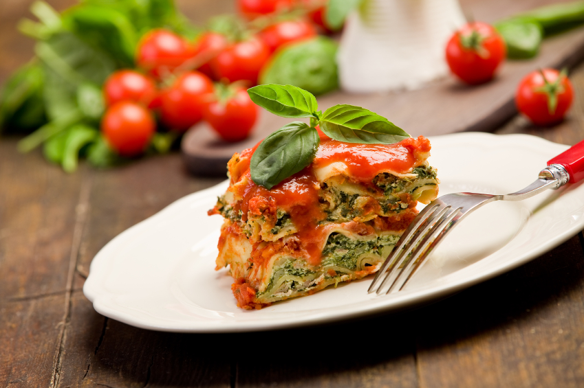 Lasagne with ricotta cheese on a white plate