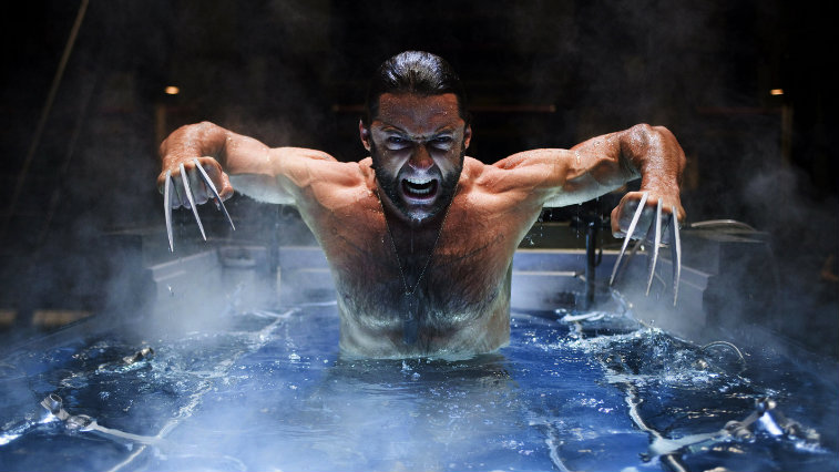 Hugh Jackman as Wolverine in a pool looking angry and bearing his claws