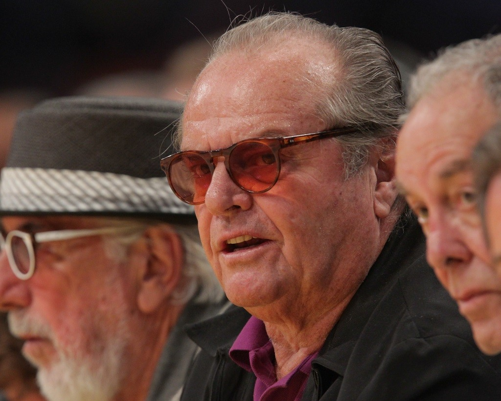 Jack Nicholson sitting in a crowd of people.