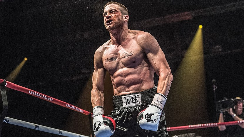 Jake Gyllenhaal, shirtless and wearing boxing gloves