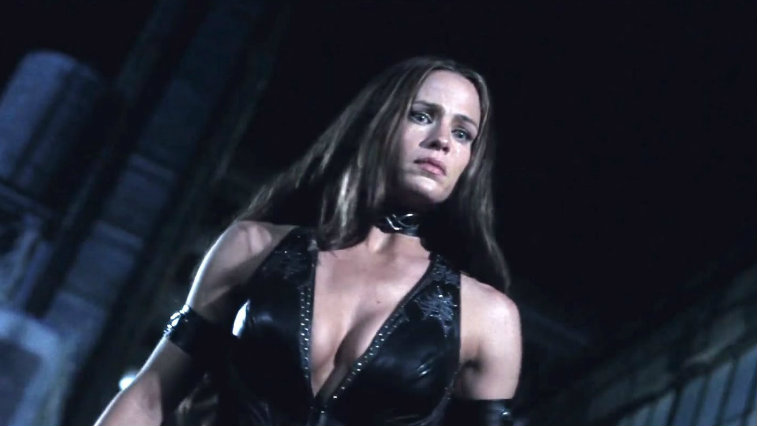 Jennifer Garner looks down in a leather outfit in Daredevil.
