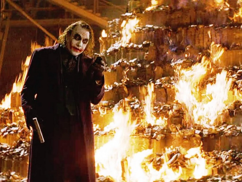The Joker burns stacks of money, just to prove a point