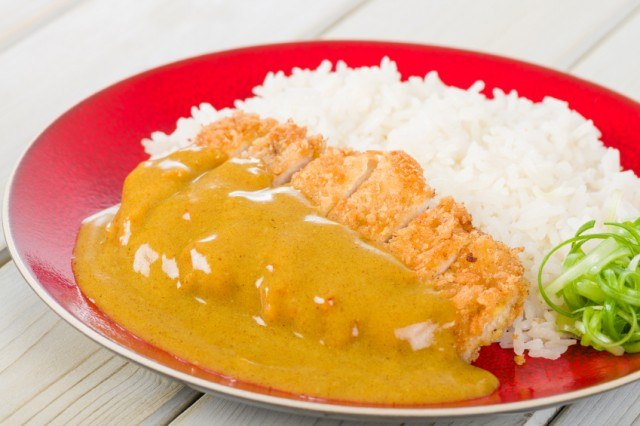 crispy breaded chicken or pork cutlet with rice and sauce