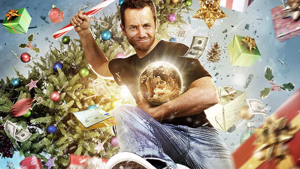 Kirk Cameron is holding a candy cane and jumping in Saving Christmas