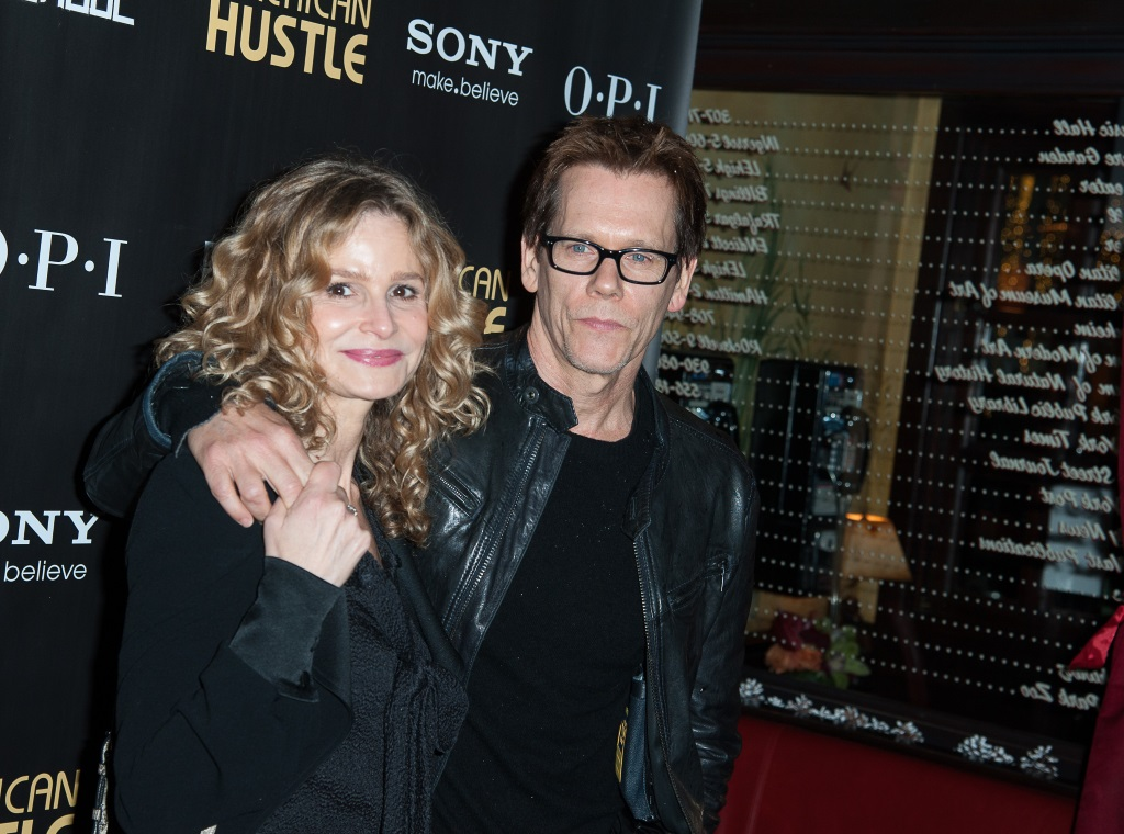 Kevin Bacon has his arm around Kyra Sedgwick on the red carpet.