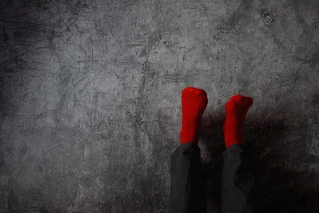 Legs up the wall wearing red socks