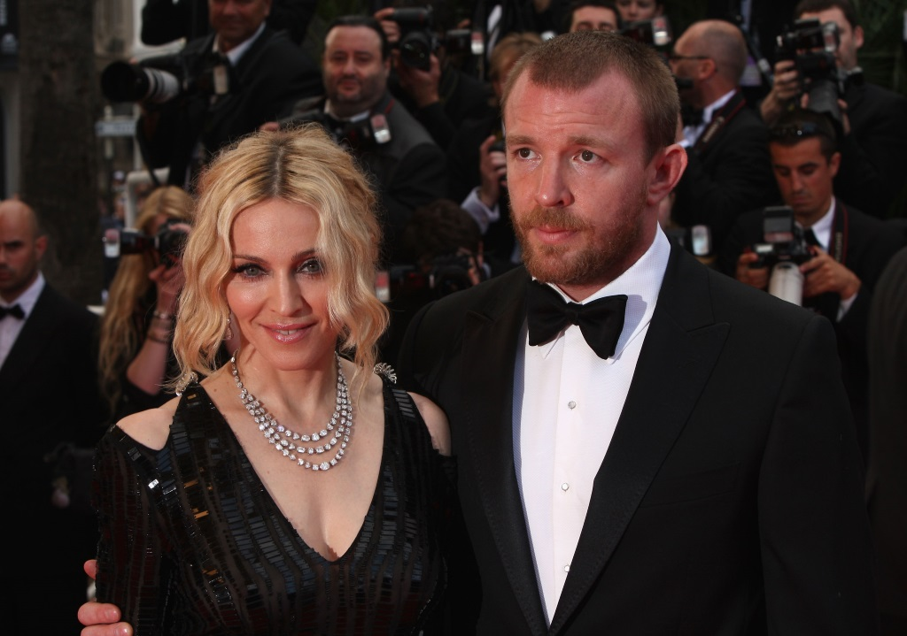 Madonna and director Guy Ritchie pose on the red carpet.