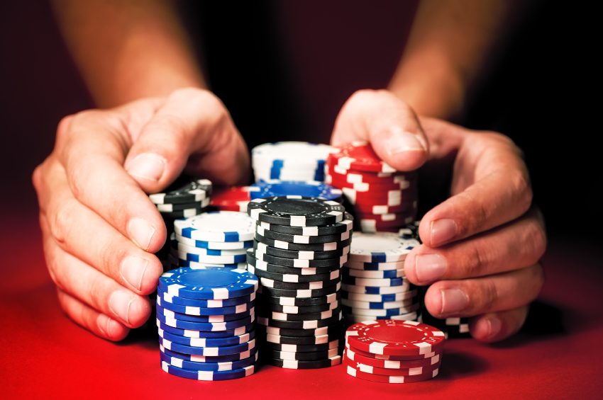 hands holding casino chips, potential gambling problem