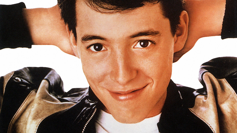 Matthew Broderick smiles with his hands behind his head in Ferris Bueller's Day Off