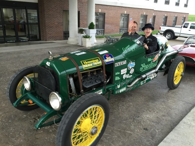 Jean Jennings at McPherson College in the Peerless Green Dragon with Jonathan Klinger from Hagerty