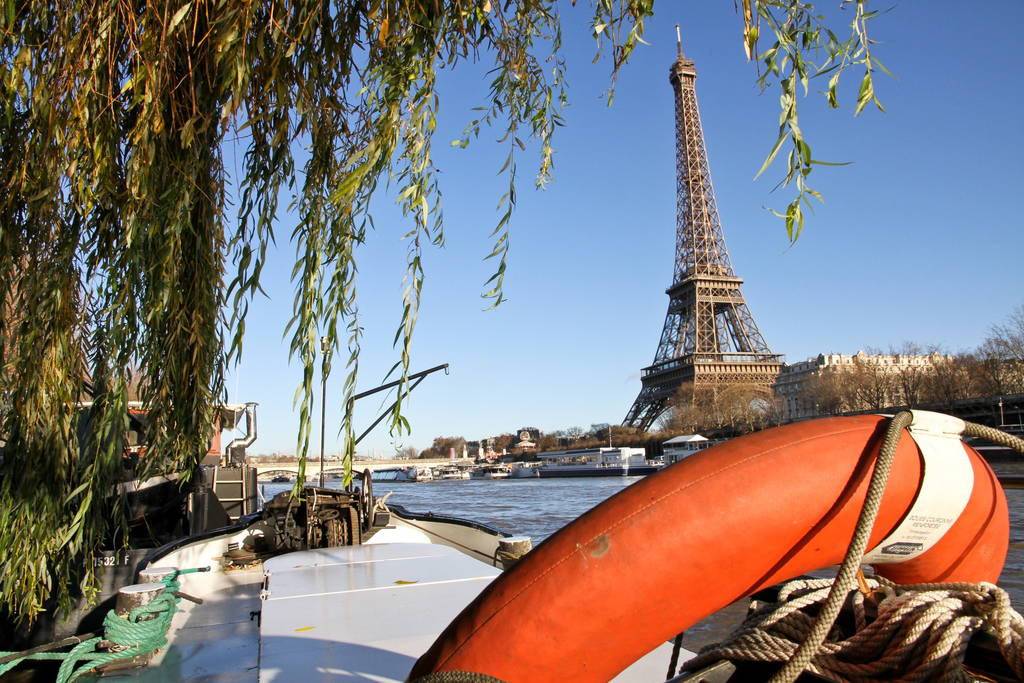 paris houseboat with view of eiffel tower