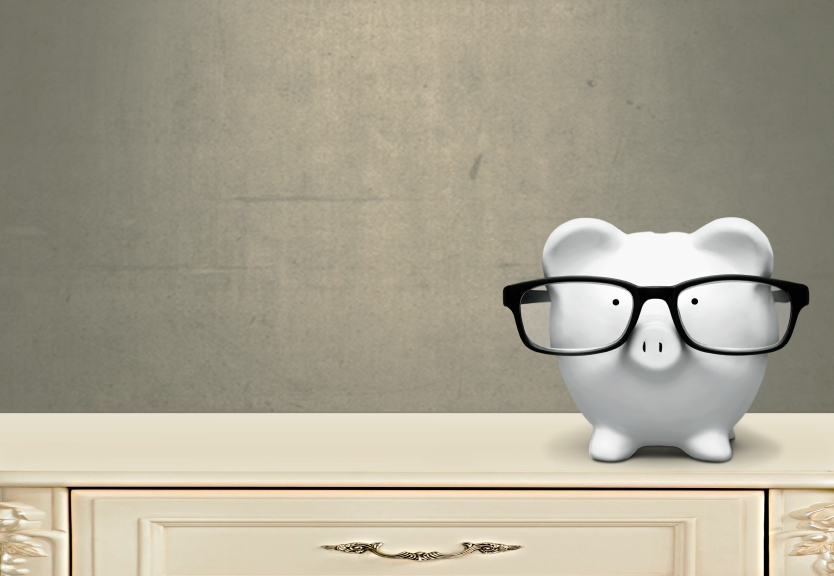 piggy bank wearing glasses
