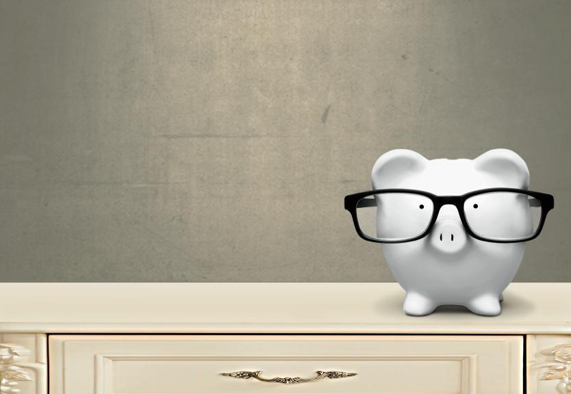 piggy bank wearing glasses