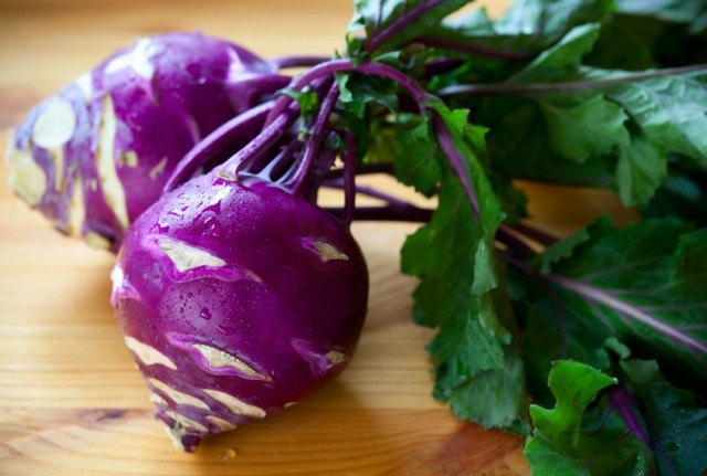 bunch of purple kohlrabi on a wooden table