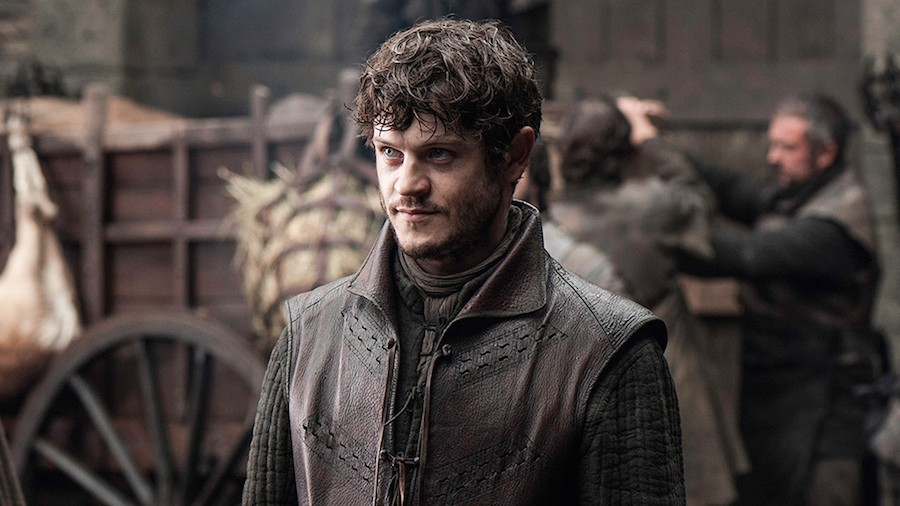Ramsay Bolton, wearing a brown leather vest, and smiling menacingly off to the left of the frame