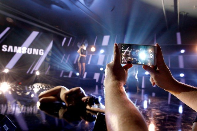 A festival goer takes a photo on a Samsung Note5 of singer Sia performing onstage at Samsung Galaxy Life Fest at SXSW 2016 on March 13, 2016 in Austin, Texas.