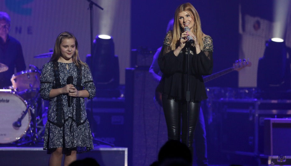 Connie Britton sings on stage in a scene from Nashville