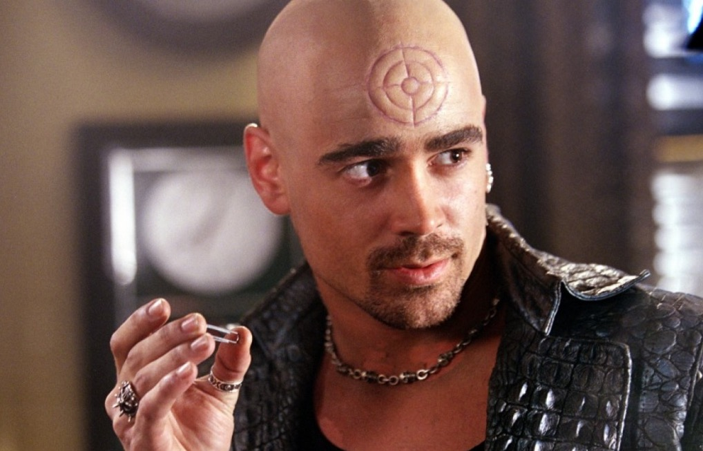 Colin Farrell as Bullseye, holding a paperclip in two fingers and looking to his left