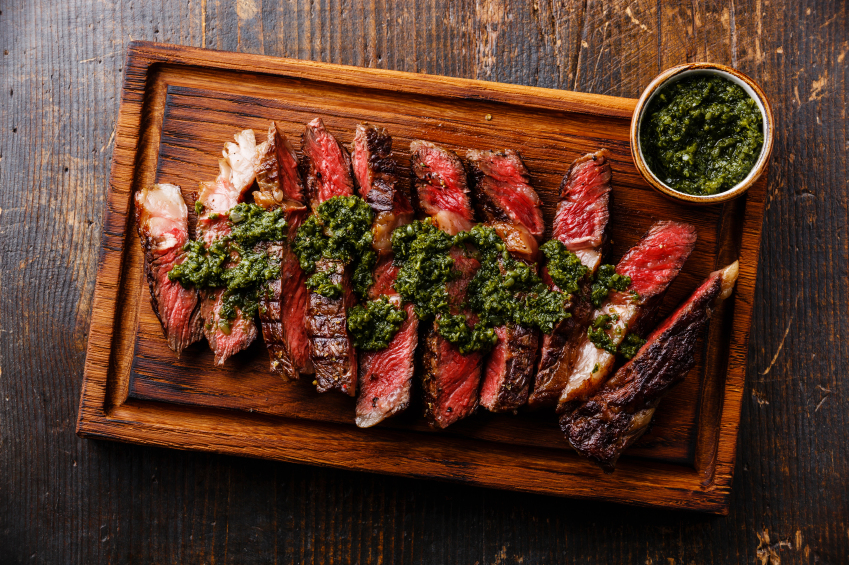 Sliced grilled beef barbecue on a wooden board