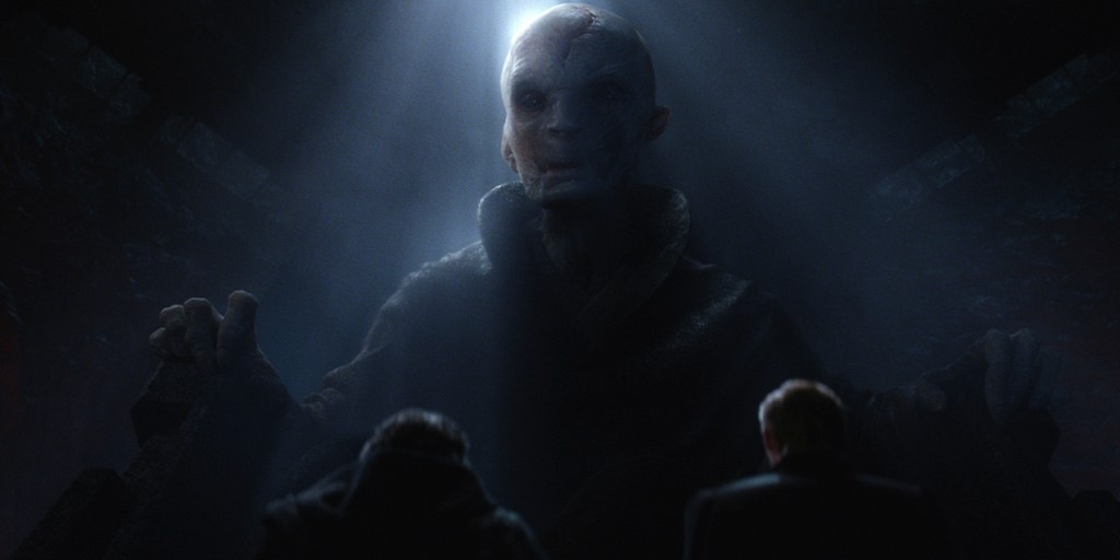 Snoke in a chair, shrouded in shadow, looking down at the camera