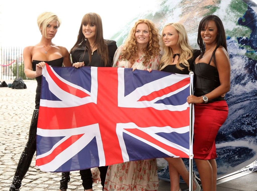 The Spice Girls holding a British flag