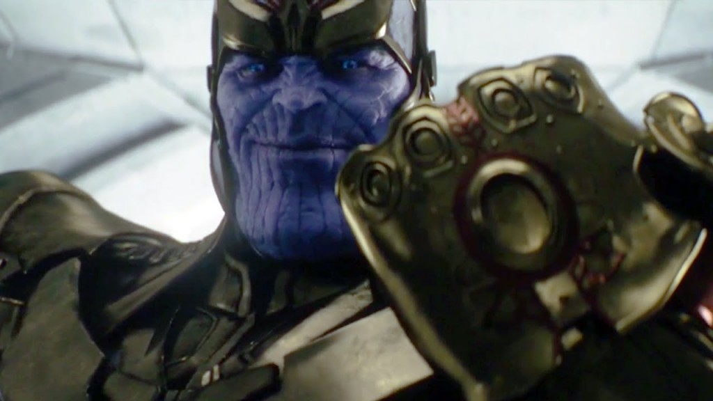 Thanos holds up his uncompleted Infinity Gauntlet at the end of Avengers: Age of Ultron