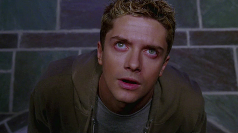 Topher Grace in Spider-Man 3, looking straight up and wearing a brown jacket