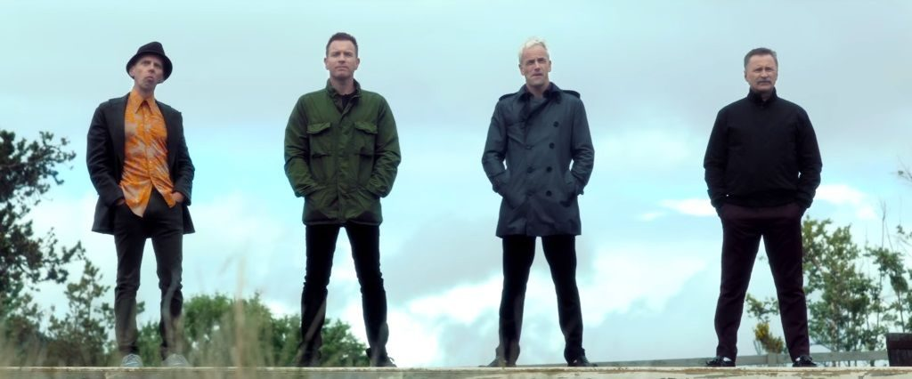 The cast of Trainspotting 2 standing in a field