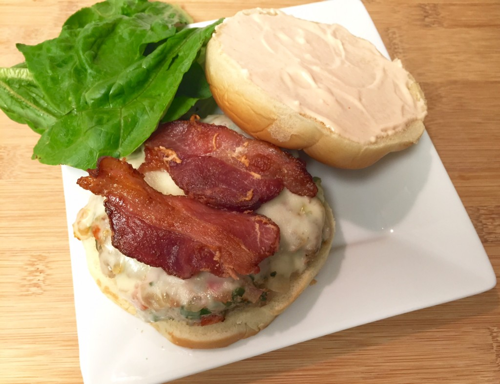 Turkey burger with bacon and lettuce on a roll