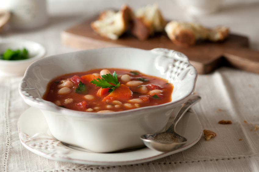spinach tomato soup in a white bowl