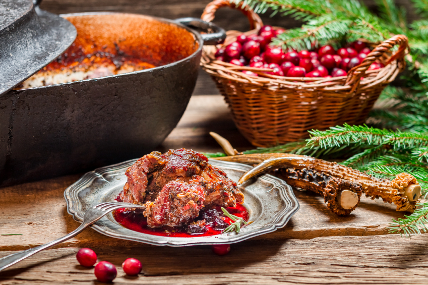 pork chops with cranberry sauce in a plate