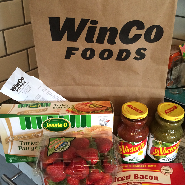 WinCo groceries with shopping bag