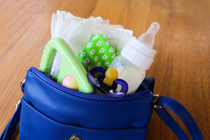 diaper bag stuffed with supplies to take care of a baby