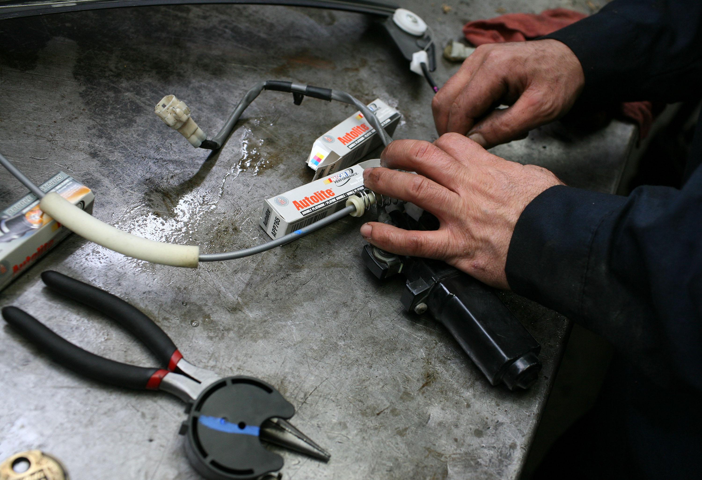An auto mechanic at work