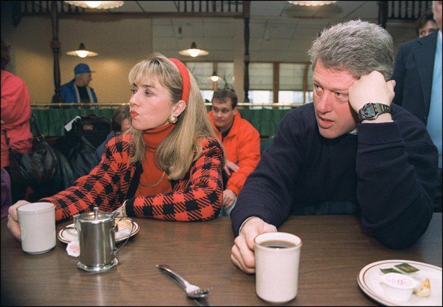 Bill and Hillary Clinton relax during a campaign stop.