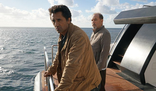 Travis (Cliff Curtis) and Salazar (Ruben Blades) stand on the deck of Strand's boat, the <em>Abigail</em>, in a scene from the second season of 'Fear the Walking Dead.'