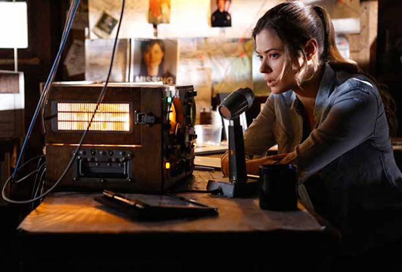 Peyton List speaks into a microphone in a scene from Frequency