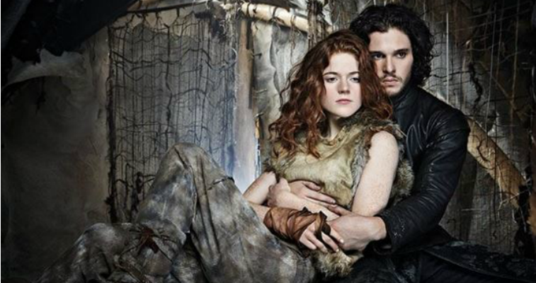 Jon Snow and Ygritte are cuddling together.