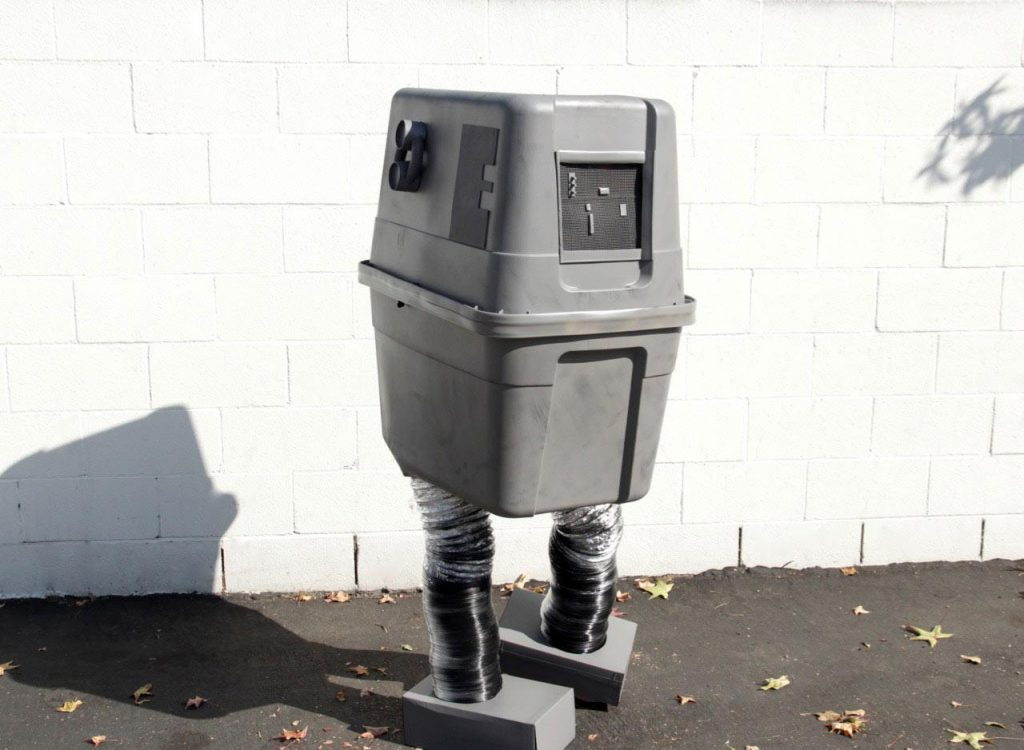 A fan repurposes a garbage can to dress up like a boxy GNK droid from Star Wars