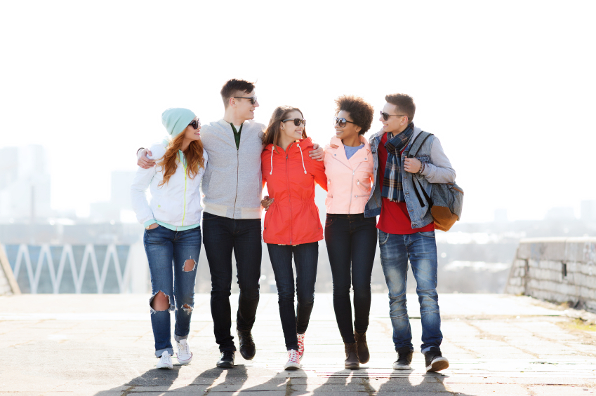 group of young friends walking together on a sunny day