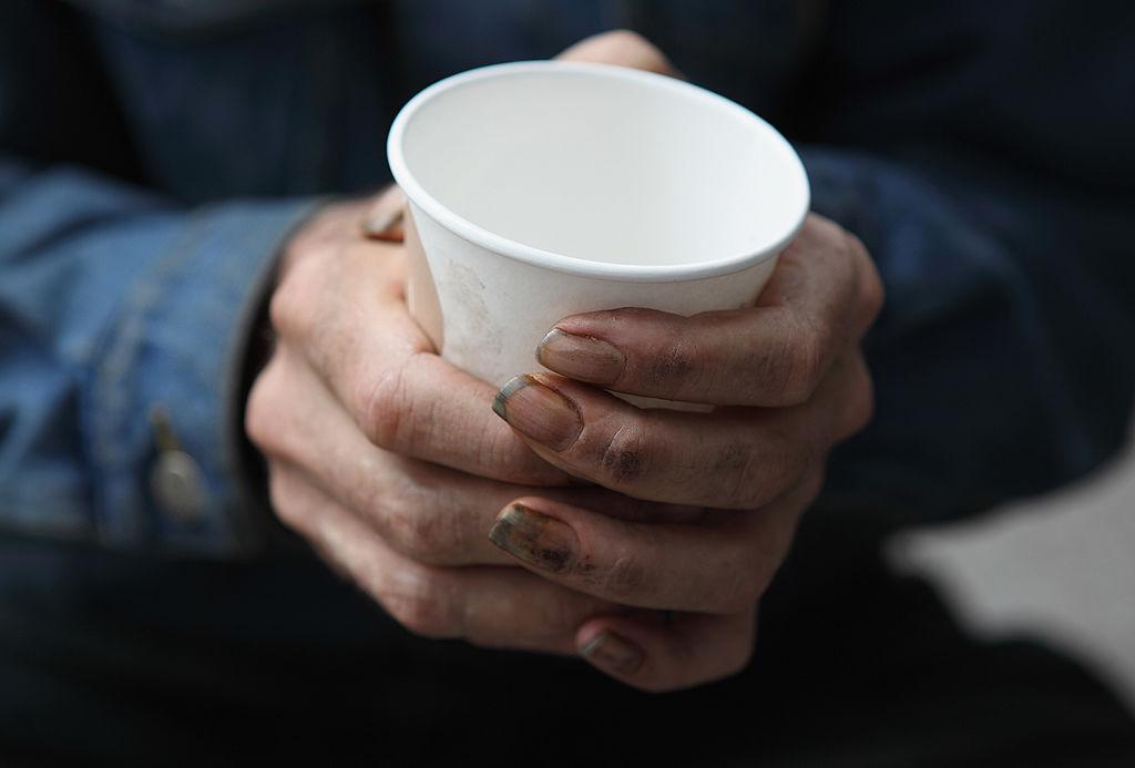 homeless man in poverty panhandling