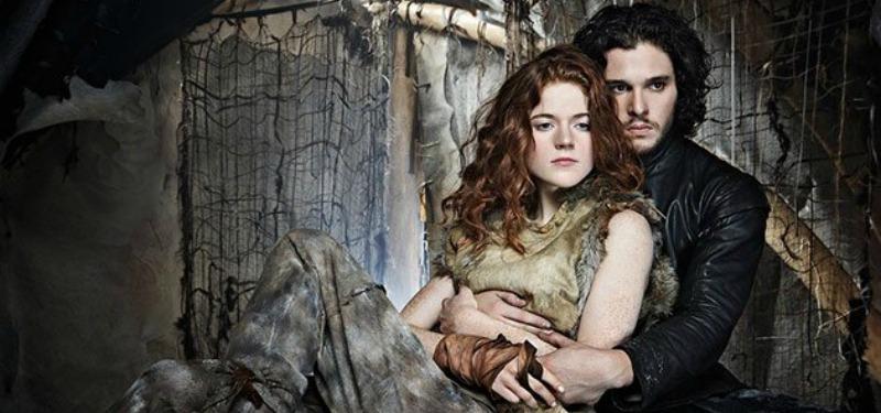 Kit Harrington as Jon Snow wraps his arms around real-life fiancee Rose Leslie as Ygritte