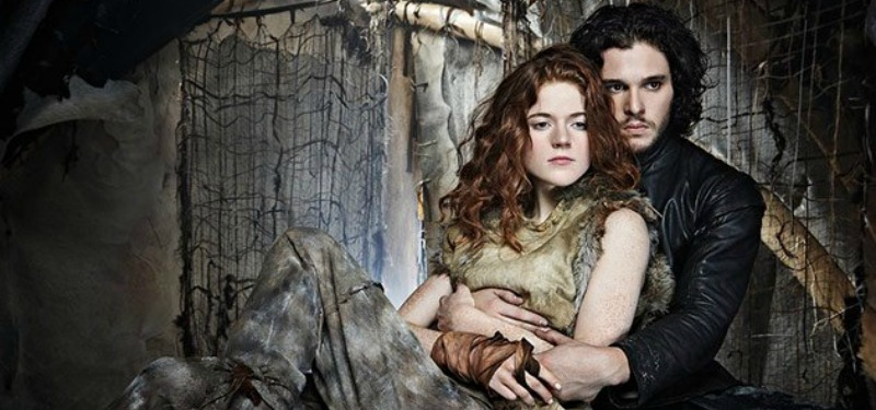 Kit Harrington as Jon Snow wraps his arms around real-life fiancee Rose Leslie as Ygritte